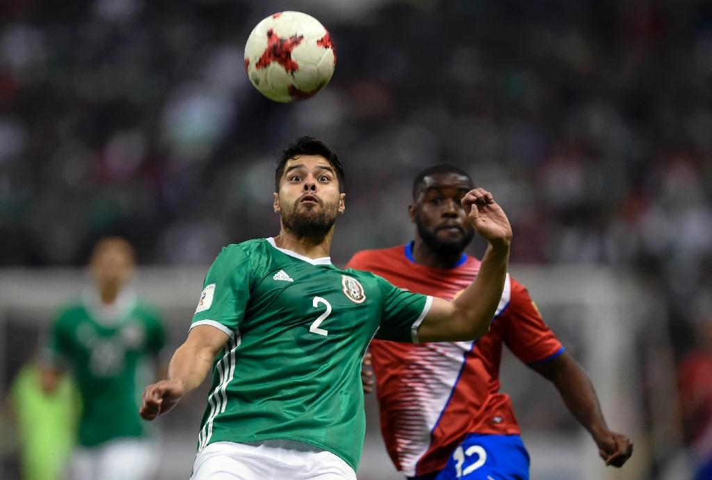 Javier Hernandez and Nestor Araujo (front) scored for Mexico as they moved to the top of the 2018 World Cup qualification standings with a 2-0 defeat of Costa Rica (AFP Photo/ALFREDO ESTRELLA)