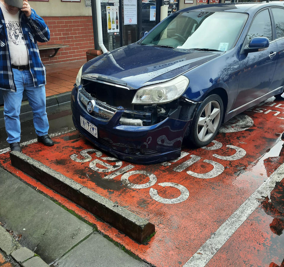 A car is shown with its bumper falling off. Source: Facebook
