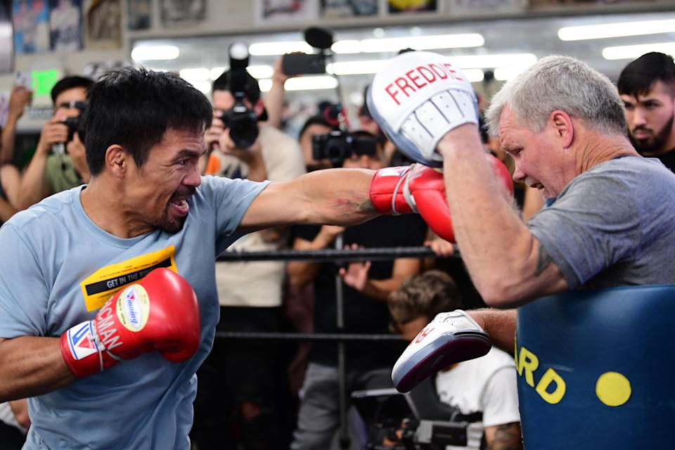 Eight-division world champion boxer Manny Pacquiao (L) spars with coach Freddy Roach in Hollywood, California on July 10, 2019. - Pacquiao is training ahead of his July 20 bout against Welterweight World Champion Keith Thurman. (Photo by FREDERIC J. BROWN / AFP)        (Photo credit should read FREDERIC J. BROWN/AFP/Getty Images)