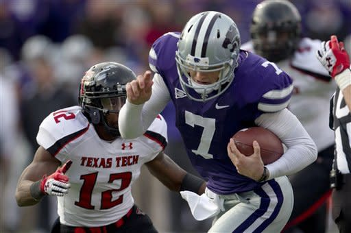 Kansas State quarterback Collin Klein (7) breaks past Texas Tech safety D.J. Johnson (12) for a touchdown during the second half of an NCAA college football game in Manhattan, Kan., Saturday, Oct. 27, 2012. (AP Photo/Orlin Wagner)