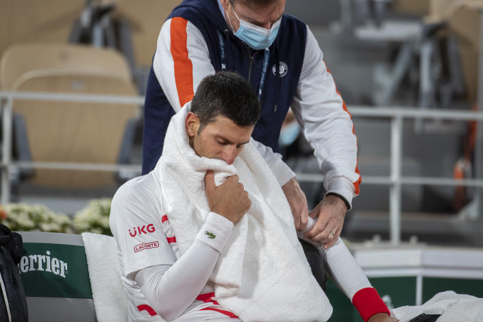PARIS, FRANCE October 07. Novak Djokovic of Serbia receiving treatment on his elbow during his match against Pablo Carreno Busta of Spain in the Quarter Finals of the singles competition on Court Philippe-Chatrier during the French Open Tennis Tournament at Roland Garros on October 7th 2020 in Paris, France. (Photo by Tim Clayton/Corbis via Getty Images)