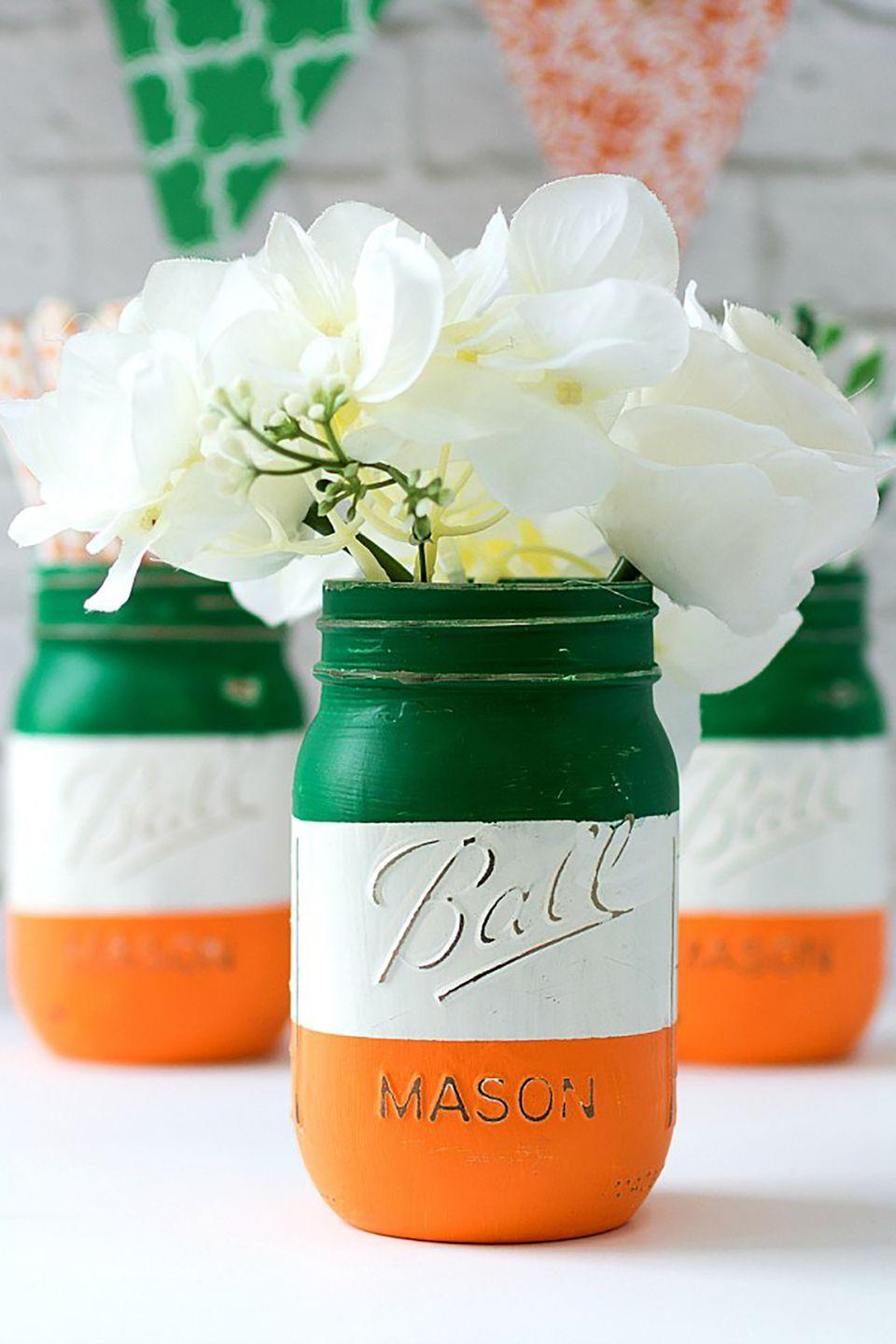 """<p>If you have any Irish blood in you, celebrate your ancestry with these bright and beautiful jars.</p><p><strong>Get the tutorial at <a href=""""http://masonjarcraftslove.com/irish-flag-mason-jars/"""" rel=""""nofollow noopener"""" target=""""_blank"""" data-ylk=""""slk:Mason Jar Crafts"""" class=""""link rapid-noclick-resp"""">Mason Jar Crafts</a>. </strong></p>"""