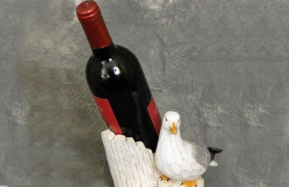 <b>7. Seagull Wine:</b> This one has to be the manliest drink around. Invented by the Eskimos to brave the cold arctic weather, this one is made by mutilating a seagull, chopping it into pieces or storing it whole in a bottle of water, and leaving it in the sun for a prolonged period of time till it ferments.