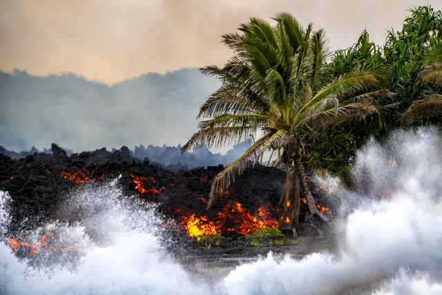"""<p>""""I am filled with sadness and joy at the same time. This is the duality that is the volcano."""" (Photo: CJ Kale/Caters News) </p>"""