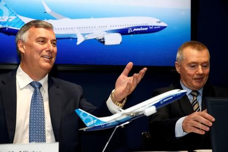 FILE PHOTO: Boeing Commercial Airplanes CEO Kevin McAllister and International Airlines Group CEO Willie Walsh attend the Boeing 737 MAX 8 commercial announcement during the 53rd International Paris Air Show at Le Bourget Airport near Paris