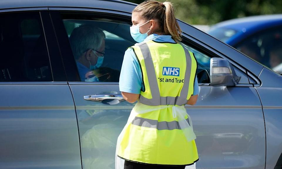 Serco staff working on behalf of NHS Test and Trace operate a coronavirus testing centre in Stone, England.