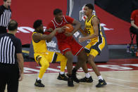 Ohio State's E.J. Liddell, center, fights for the ball against Iowa's Joe Toussaint, left, and Keegan Murray during the second half of an NCAA college basketball game Sunday, Feb. 28, 2021, in Columbus, Ohio. (AP Photo/Jay LaPrete)