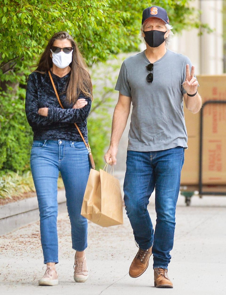 <p>Jon Bon Jovi and his wife, Dorothea, step out to pick up some takeout in N.Y.C. on Wednesday. </p>