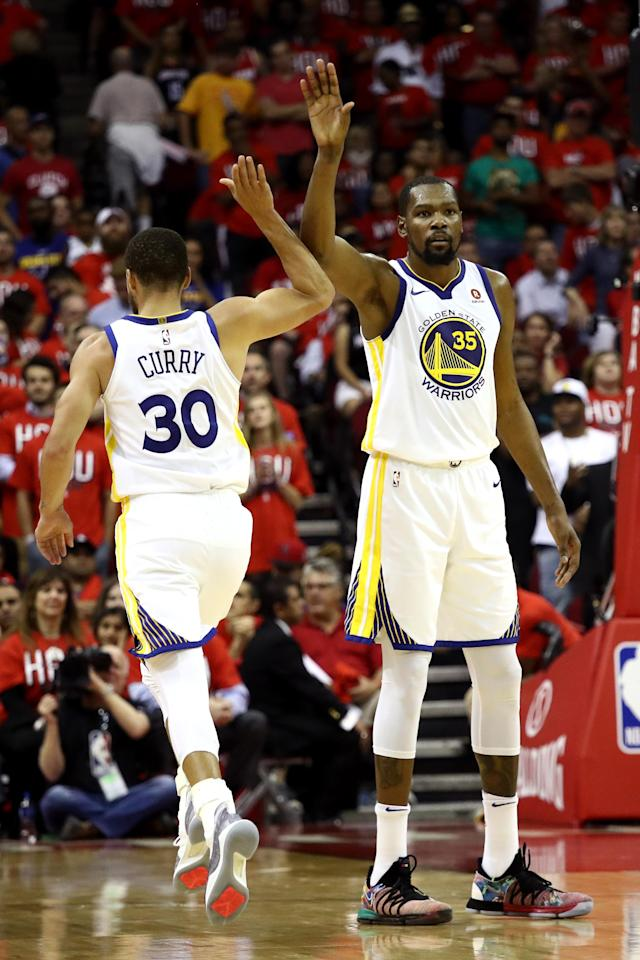 HOUSTON, TX - MAY 14: Stephen Curry #30 and Kevin Durant #35 of the Golden State Warriors react late in the game against the Houston Rockets in Game One of the Western Conference Finals of the 2018 NBA Playoffs at Toyota Center on May 14, 2018 in Houston, Texas. (Photo by Ronald Martinez/Getty Images)