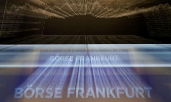 FILE PHOTO: The German share prize index (DAX) board is seen at the end of a trading day at the German stock exchange (Deutsche Boerse) in Frankfurt