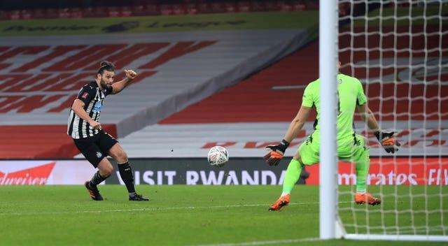 Andy Carroll, left, is denied by Bernd Leno