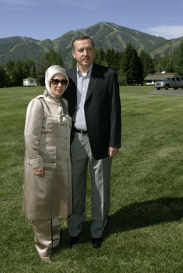 <p>Recep Tayyip Erdogan, the prime minister of Turkey, and his wife, Emine, stop to have the picture taken with a mountain background as they head back to their room at the annual Allen and Co.'s media conference Wednesday, July 6, 2005, in Sun Valley, Idaho. (AP Photo/Douglas C. Pizac) </p>