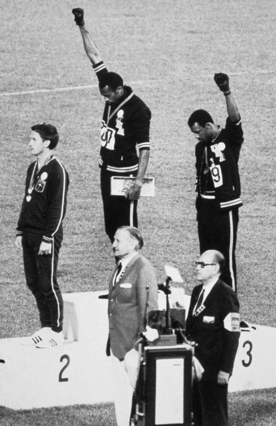 <p>To protest racism in the States, sprinters Tommie Smith and John Carlos put on scarves and beads—to represent lynching—and took off their shoes—a symbol of poverty—before taking the podium. During the national anthem, they bowed their heads and raised their fists in the Black Power salute. Their protest is one of the most iconic sports moments of all time. </p>