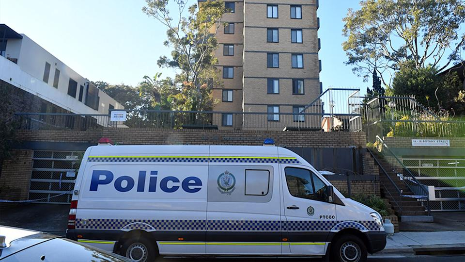 A NSW Police car outside the Bondi Junction apartment building as residents serve out 14 days in isolation.