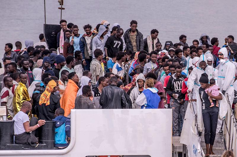 CATANIA, ITALY - JUNE 13: Migrants disembark the Italy's coastguard ship Diciotti at the port of Catania on June 13, 2018 in Catania, Italy. The Diciotti ship carried 932 migrants rescued in Mediterranean Sea in the last days, and two bodies. Among the rescued people there were children and 13 pregnant women. The Italian interior Minister, Matteo Salvini said on Sunday that all Italian ports were closed to the rescue boat Aquarius chartered by Sos Mediterranee. (Photo by Fabrizio Villa/Getty Images) (Photo: Fabrizio Villa via Getty Images)