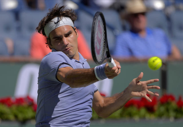 Roger Federer, of Switzerland, hits to Dmitry Tursunov, of Russia, during a third round match at the BNP Paribas Open tennis tournament, Monday, March 10, 2014 in Indian Wells, Calif. (AP Photo/Mark J. Terrill)