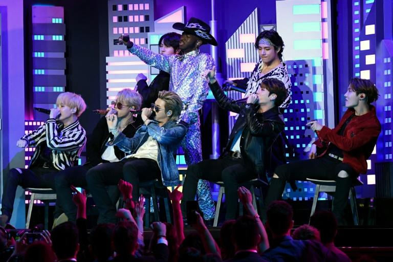 """US rapper Lil Nas X (C) performed his mega-hit """"Old Town Road"""" at the Grammys with a coterie of guest stars including South Korean boy band BTS"""