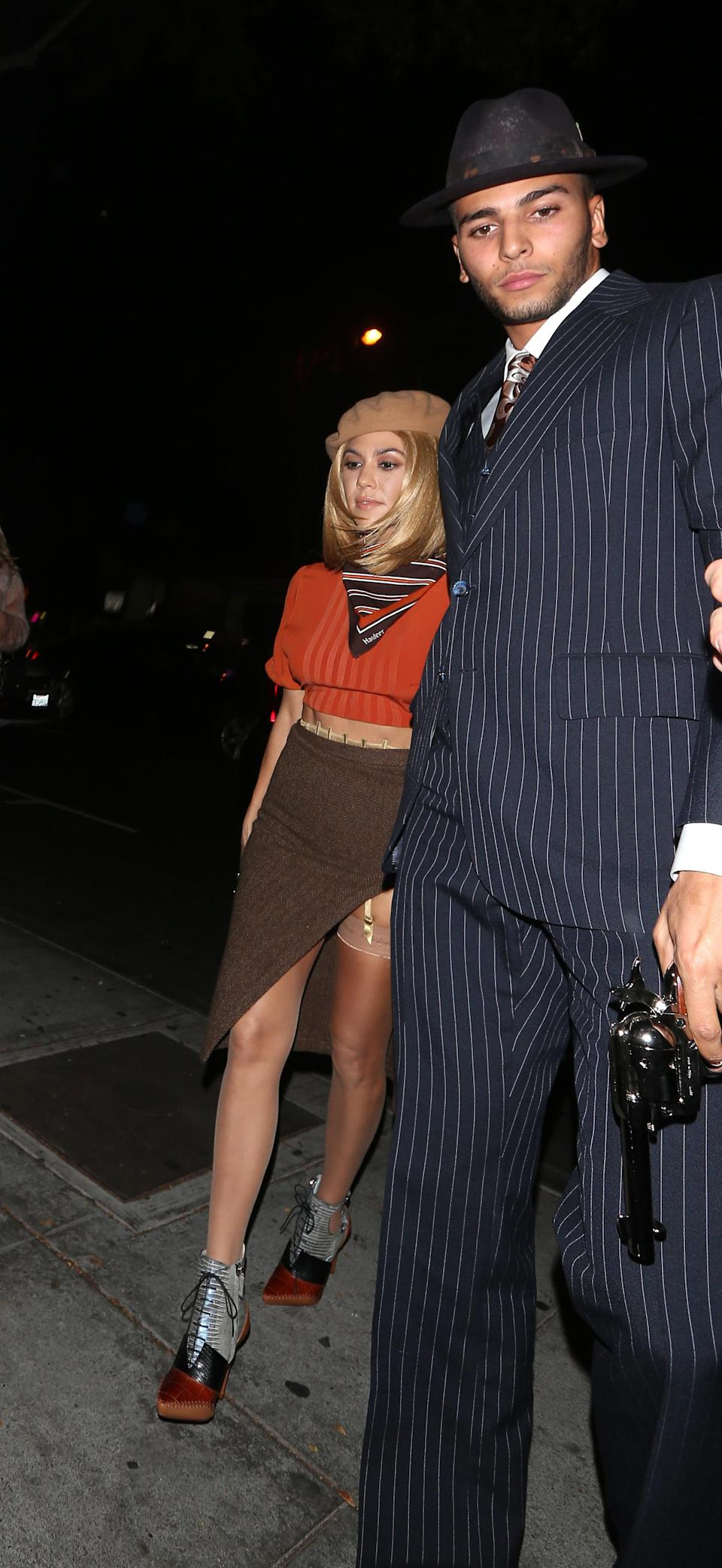 <p>Among the guests at Kendall's Halloween birthday bash was her big sis, who did a couple costume — Bonnie and Clyde — with boyfriend Younes Bendjima. (Photo: Splash News) </p>