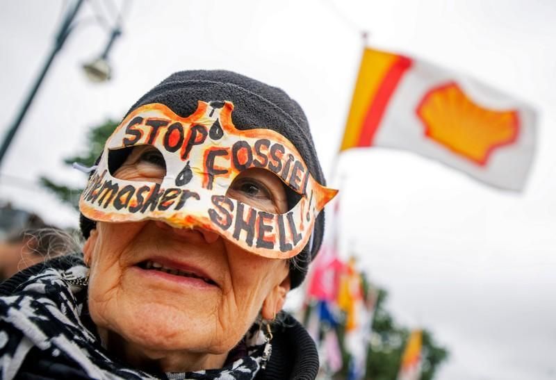 Environmental activists demonstrate outside the Royal Dutch Shell's annual general shareholder meeting in Scheveningen