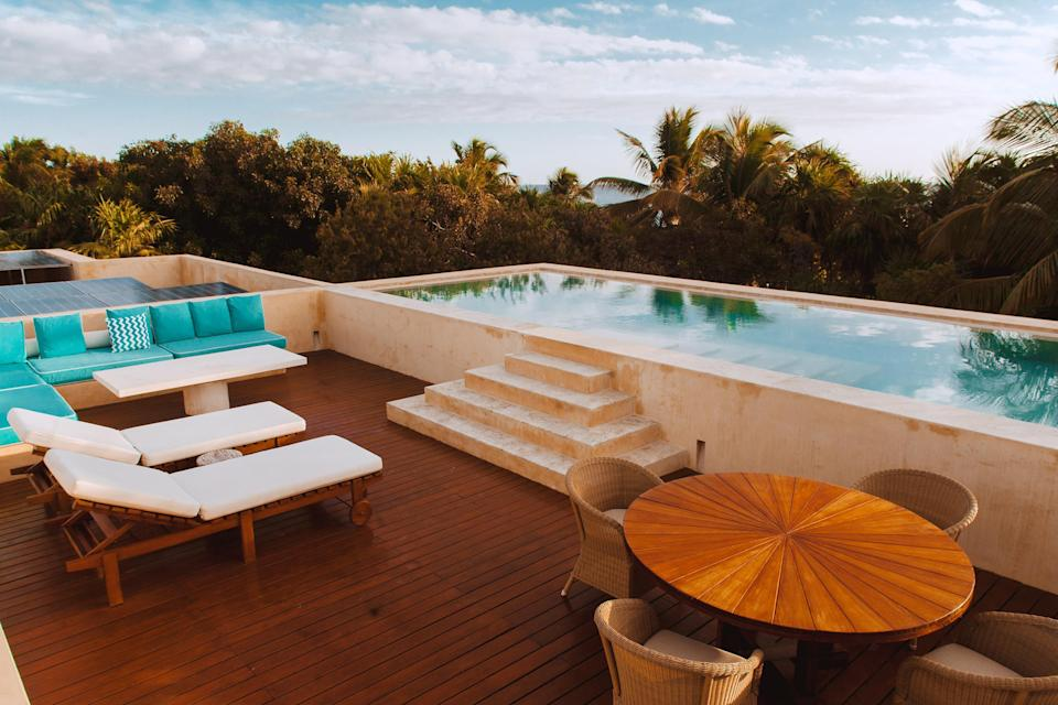 """Now this is luxe: This four-bedroom villa features a rooftop pool and multiple outdoor living areas with views of the ocean and the jungle, with two master suites set in individual casitas just off the main house for ultimate privacy. (One even has an outdoor shower.) Plus, you're just steps from the white sand beach and less than five miles from Tulum. Before you balk at the price, know that the rate includes a private chef, who will work with you to set up a menu for all your meals, and a house manager, who can help you arrange visits to nearby cenotes, fishing trips, and more. <em>(From 450,000 points per night)</em> $2700, Marriott. <a href=""""https://homes-and-villas.marriott.com/en/properties/78106314-bocapaila-idyllic-beachfront-villa-with-rooftop-pool-and-staff"""" rel=""""nofollow noopener"""" target=""""_blank"""" data-ylk=""""slk:Get it now!"""" class=""""link rapid-noclick-resp"""">Get it now!</a>"""