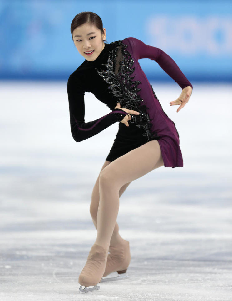 Yuna Kim of South Korea competes in the women's free skate figure skating finals at the Iceberg Skating Palace during the 2014 Winter Olympics, Thursday, Feb. 20, 2014, in Sochi, Russia. (AP Photo/Ivan Sekretarev)