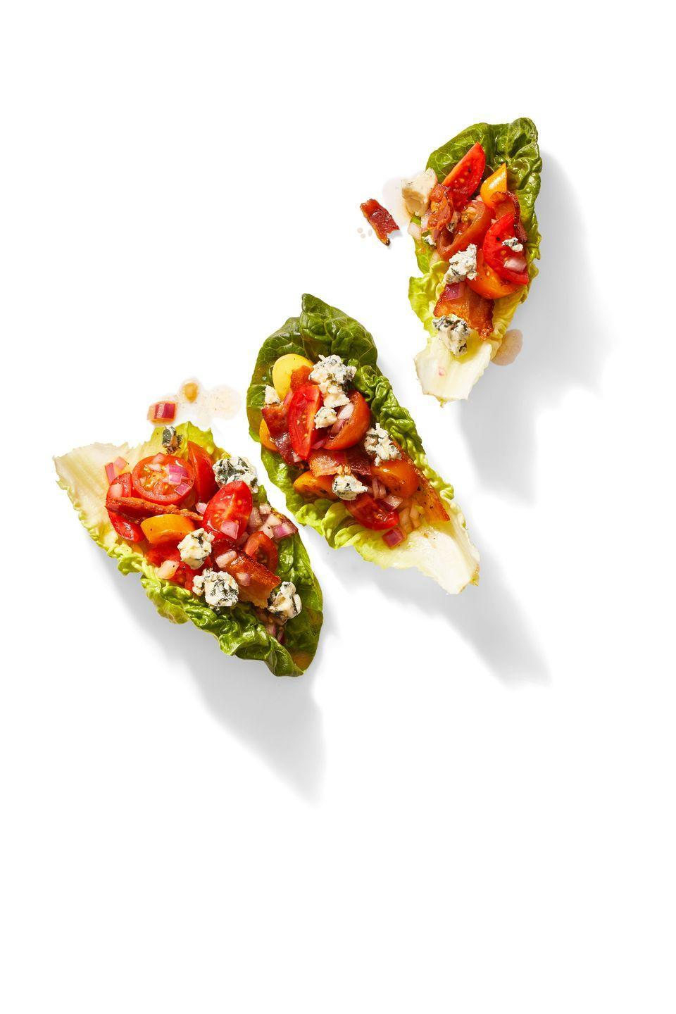 """<p>Make BLTs for a crowd by stuffing them into adorable lettuce cups.</p><p><em><a href=""""https://www.goodhousekeeping.com/food-recipes/a35190909/blt-bites-recipe/"""" rel=""""nofollow noopener"""" target=""""_blank"""" data-ylk=""""slk:Get the recipe for BLT Bites »"""" class=""""link rapid-noclick-resp"""">Get the recipe for BLT Bites »</a></em></p>"""