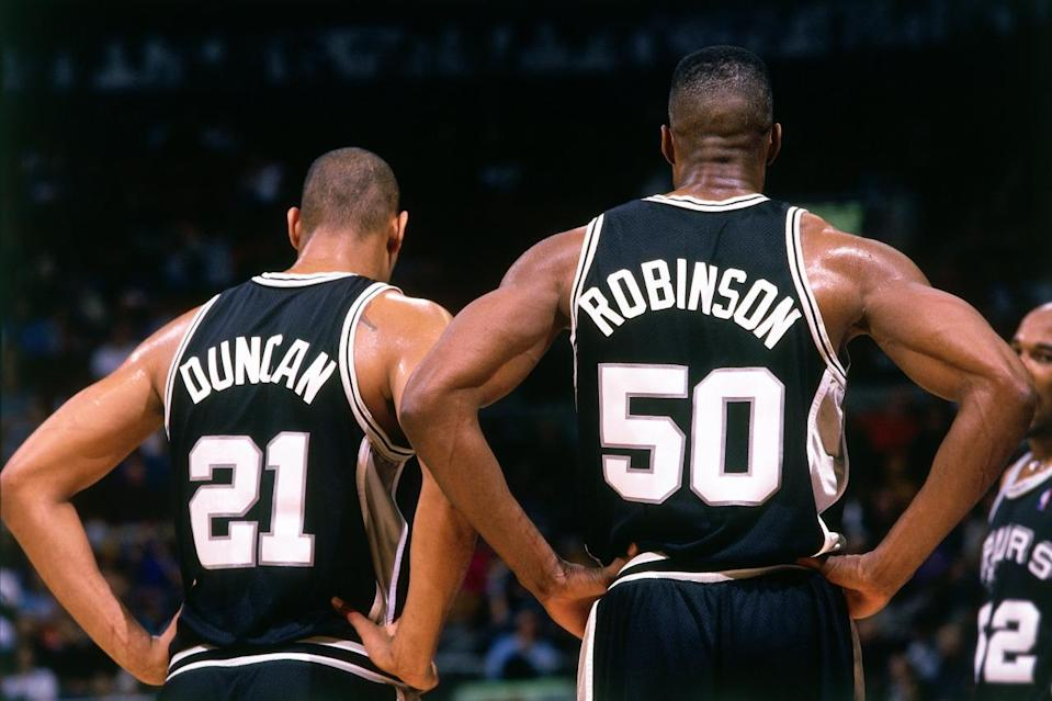 <p>2000: Tim Duncan #21 and David Robinson #50 of the San Antonio Spurs catch their breath against the Toronto Raptors during a 2000 NBA game at the Air Canada Center in Toronto, Canada.<br></p>