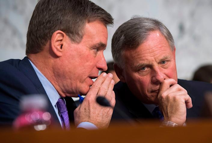Sen. Richard Burr (R-N.C.), right, speaks with Sen. Mark Warner (D-Va.) before a confirmation hearing for Christopher Sharpley, nominee for inspector general of the CIA, on Oct. 17, 2017.