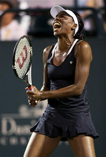 Venus Williams, of the United States, reacts to a poor shot while playing Jelena Jankovic, of Serbia, at the Family Circle Cup tennis tournament in Charleston, S.C., Wednesday April 4, 2012.   (AP Photo/Mic Smith)