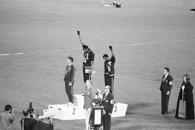 Tommie Smith and John Carlos raise their fists at the 1968 Olympic Games. (Getty Images)