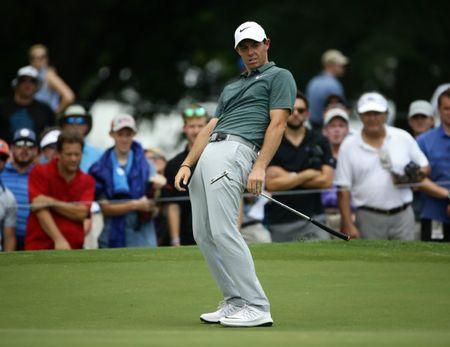 Aug 12, 2017; Charlotte, NC, USA; Rory McIlroy reacts to his putt on the fourth green during the third round of the 2017 PGA Championship at Quail Hollow Club. Mandatory Credit: Rob Schumacher-USA TODAY Sports