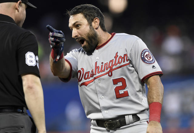 Washington Nationals' Adam Eaton, right, argues with first base umpire Mike Estabrook after a double play was turned during the top of the third inning of a baseball game against the New York Mets, Monday, May 20, 2019, in New York. (AP Photo/Sarah Stier)