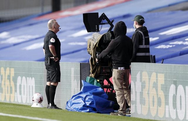 Jonathan Moss had to check the pitchside monitor to downgrade Kyle Walker-Peters' red card