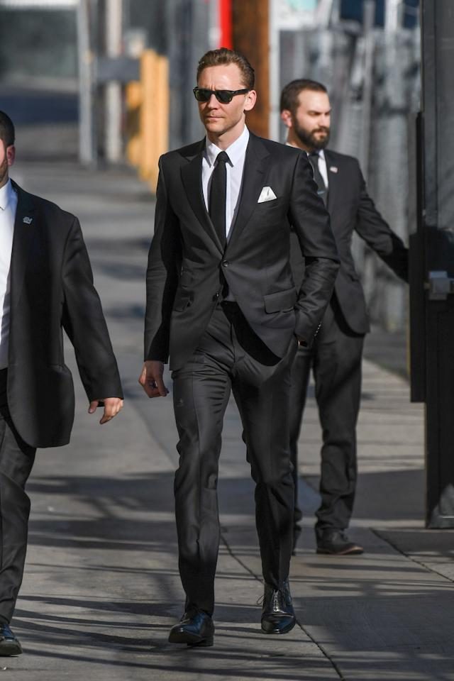 """<p>Tom Hiddleston is a man who can do both but, let's be real, dressing up is his true strength. He can wear a <a rel=""""nofollow"""" href=""""http://www.gq.com/gallery/tom-hiddleston-style-look-book-suits?mbid=synd_yahoostyle#2"""">cranberry double-breasted suit</a> or a <a rel=""""nofollow"""" href=""""http://www.gq.com/story/tom-hiddleston-gucci-suit-kong-red-carpet?mbid=synd_yahoostyle"""">sober navy two-button style</a> or some <a rel=""""nofollow"""" href=""""http://www.gq.com/gallery/tom-hiddleston-style-look-book-suits?mbid=synd_yahoostyle#7"""">ye-ole-English three-piece kit</a> with equal charm. He can wear <a rel=""""nofollow"""" href=""""http://www.gq.com/story/tom-hiddleston-aquatalia-boots?mbid=synd_yahoostyle"""">flat-front chinos</a>, and <a rel=""""nofollow"""" href=""""http://www.gq.com/gallery/tom-hiddleston-style-look-book-suits?mbid=synd_yahoostyle#11"""">notch-lapel blazers</a>, and <a rel=""""nofollow"""" href=""""http://www.gq.com/story/tom-hiddleston-dress-shirt-pink?mbid=synd_yahoostyle"""">weird-color button-down shirts</a>. Basically, if it's respectable enough to wear in an office, he's done it and he's knocked it out of the park. Cementing his status as an office style hero was this Gucci look, which Hiddleston wore on <em>Jimmy Kimmel Live</em> yesterday. Just when you thought the man had dressed up in every possible way, he goes all <em>Reservoir Dogs</em> on us; walking in slow-motion in some back alley while wearing a slim black suit and Ray-Bans.</p><p>If you are an accountant, or an agent, or an assistant of an accountant or an agent, let this look be your work wardrobe inspiration. If you are in another field, well, rest assured there's a Hiddleston look for you.</p>"""
