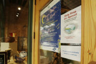 A mandatory mask usage sign is displayed at Art Spirit Gallery, Friday, Sept. 10, 2021, in Coeur d'Alene, Idaho. Northern Idaho has a long and deep streak of antigovernment activism that is confounding attempts to battle a COVID-19 outbreak. (AP Photo/Young Kwak)