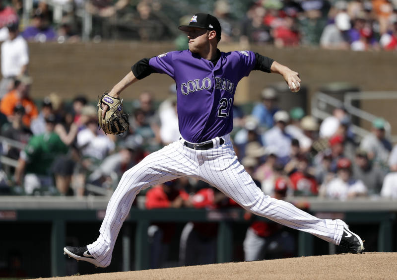 Colorado Rockies starting pitcher Kyle Freeland throws against the Cincinnati Reds in the first inning of a spring training baseball game Monday, March 18, 2019, in Scottsdale, Ariz. (AP Photo/Elaine Thompson)
