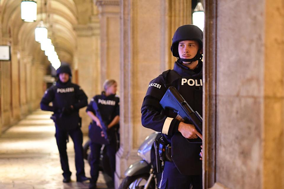 Image: Armed police patrol a passage near the opera in central Vienna (Joe Klamar / AFP - Getty Images)