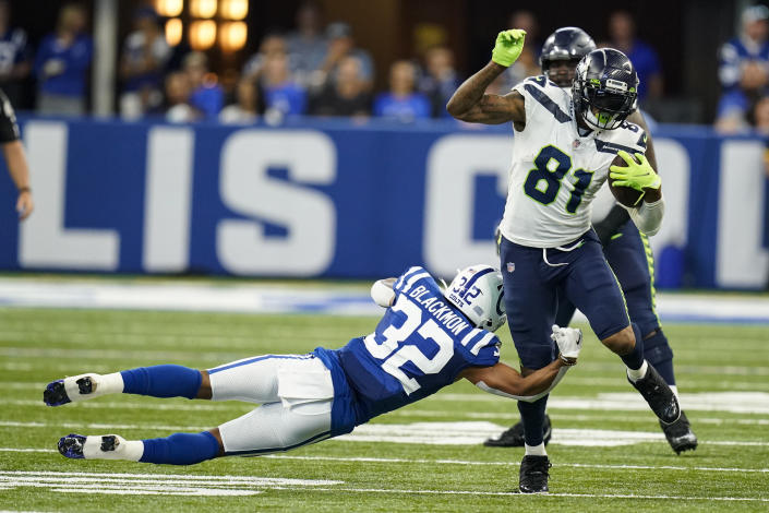 Indianapolis Colts safety Julian Blackmon (32) tackles Seattle Seahawks tight end Gerald Everett (81) in the first half of an NFL football game in Indianapolis, Sunday, Sept. 12, 2021. (AP Photo/Charlie Neibergall)