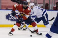 Florida Panthers left wing Anthony Duclair (91) controls the puck as Tampa Bay Lightning left wing Alex Killorn (17) defends during the second period of an NHL hockey game, Monday, May 10, 2021, in Sunrise, Fla. (AP Photo/Lynne Sladky)