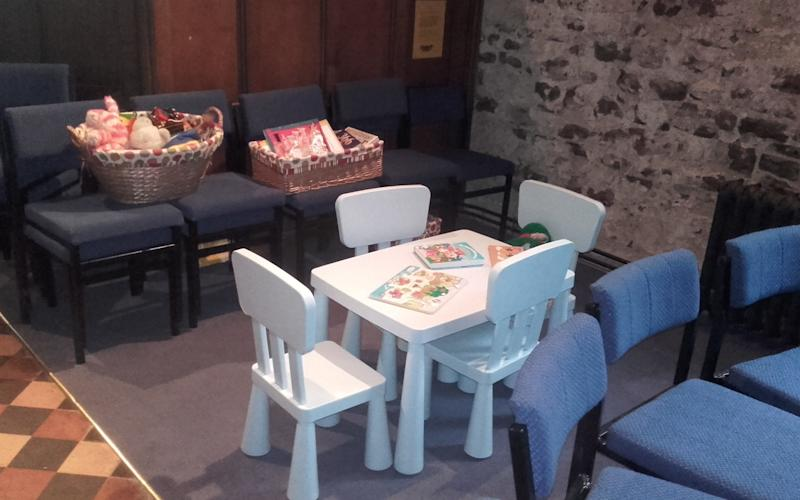 A vicar has been threatened with disciplinary action for installing a kids' plastic table and chairs into a 12th century church. - © SWNS.com