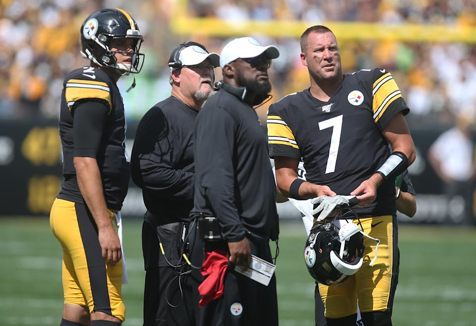 Sep 15, 2019; Pittsburgh, PA, USA;  Pittsburgh Steelers quarterback Mason Rudolph (2) and offensive coordinator Randy Fichtner (left middle) and head coach Mike Tomlin (right middle) and quarterback Ben Roethlisberger (7) watch a scoreboard replay against the Seattle Seahawks during the second quarter at Heinz Field. Mandatory Credit: Charles LeClaire-USA TODAY Sports