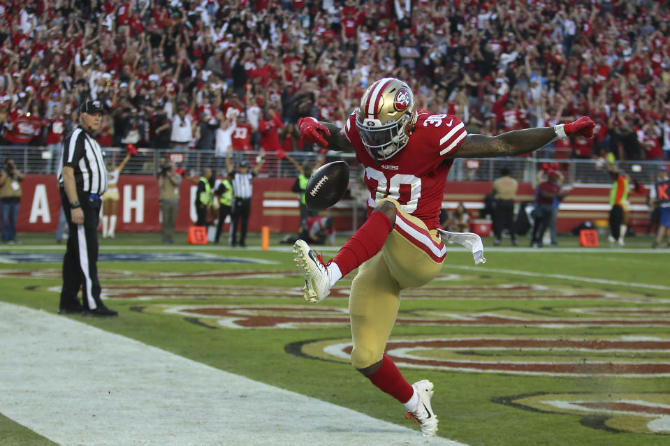 San Francisco 49ers running back Jeff Wilson Jr. (30) celebrates after scoring against the Arizona Cardinals during the second half of an NFL football game in Santa Clara, Calif., Sunday, Nov. 17, 2019. (AP Photo/John Hefti)