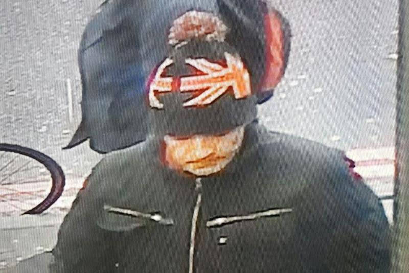 Suspect: The shop has released CCTV footage of this man after he walked out with the cat