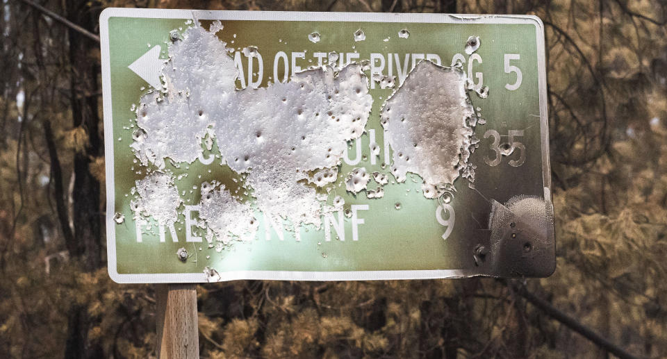 A sign damaged in one of the largest wildfires in the United States, the Bootleg fire. Source: AP