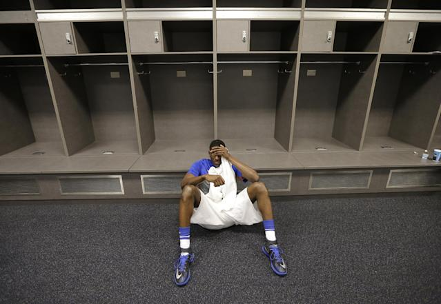 Florida forward Dorian Finney-Smith reacts in the locker room after an NCAA Final Four tournament college basketball semifinal game against Connecticut Saturday, April 5, 2014, in Arlington, Texas. Connecticut won 63-53(AP Photo/Eric Gay)