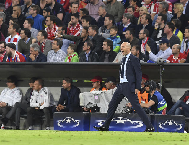 Real Madrid coach Zinedine Zidane shouts during the semifinal first leg soccer match between FC Bayern Munich and Real Madrid at the Allianz Arena stadium in Munich, Germany, Wednesday, April 25, 2018. (AP Photo/Kerstin Joensson)