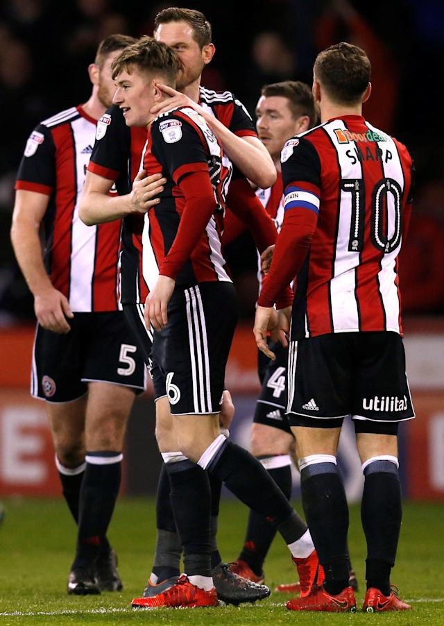 "Soccer Football - Championship - Sheffield United vs Burton Albion - Bramall Lane, Sheffield, Britain - March 13, 2018 Sheffield United's David Brooks celebrates with team mates after scoring their second goal Action Images/Ed Sykes EDITORIAL USE ONLY. No use with unauthorized audio, video, data, fixture lists, club/league logos or ""live"" services. Online in-match use limited to 75 images, no video emulation. No use in betting, games or single club/league/player publications. Please contact your account representative for further details."