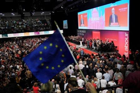 FILE PHOTO: An EU flag is waves as Britain's opposition Labour Party Leader Jeremy Corbyn delivers his keynote speech at the Labour Party Conference in Brighton, Britain, September 27, 2017. REUTERS/Toby Melville