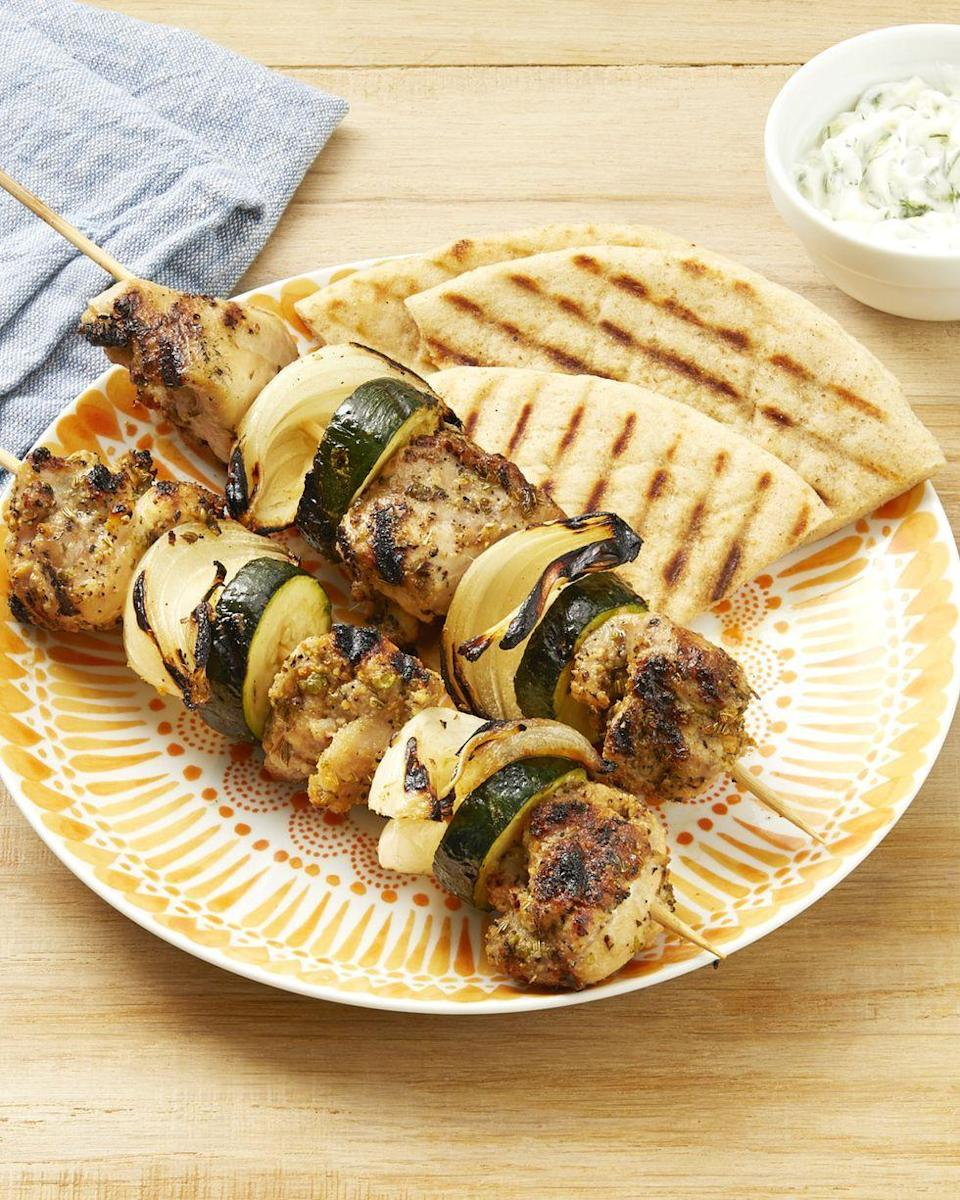 """<p>Here's a fun dinner to share with dad. The grilled chicken and veggies are served on a stick with a side of cool Greek yogurt dip. It's perfect for outdoor entertaining. </p><p><a href=""""https://www.thepioneerwoman.com/food-cooking/recipes/a32529701/greek-chicken-kebabs-recipe/"""" rel=""""nofollow noopener"""" target=""""_blank"""" data-ylk=""""slk:Get Ree's recipe."""" class=""""link rapid-noclick-resp""""><strong>Get Ree's recipe.</strong></a></p><p><a class=""""link rapid-noclick-resp"""" href=""""https://go.redirectingat.com?id=74968X1596630&url=https%3A%2F%2Fwww.walmart.com%2Fsearch%2F%3Fquery%3Dgrater&sref=https%3A%2F%2Fwww.thepioneerwoman.com%2Ffood-cooking%2Fmeals-menus%2Fg36109352%2Ffathers-day-dinner-recipes%2F"""" rel=""""nofollow noopener"""" target=""""_blank"""" data-ylk=""""slk:SHOP GRATERS"""">SHOP GRATERS</a></p>"""