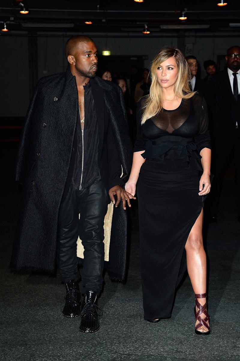 PARIS, FRANCE - SEPTEMBER 29: Kim Kardashian and Kanye West attend the Givenchy show as part of the Paris Fashion Week Womenswear Spring/Summer 2014 on September 29, 2013 in Paris, France. (Photo by Pascal Le Segretain/Getty Images)